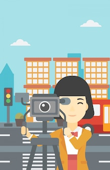 Camerawoman with movie camera on tripod.