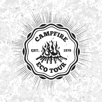 Campfire eco tour label with flaming fire on grunge background.