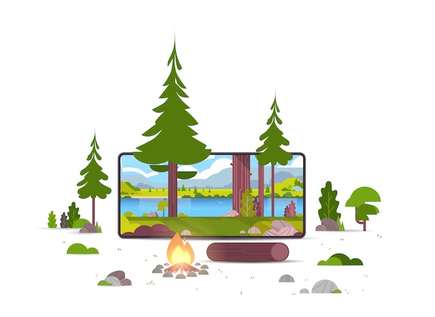 Campfire in wild summer forest beautiful river mountains landscape nature tourism camping or hiking concept smartphone screen online mobile application