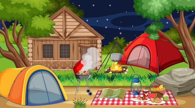 야간 자연 공원에서 캠핑 또는 피크닉 프리미엄 벡터