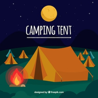 Camping tent with a campfire background