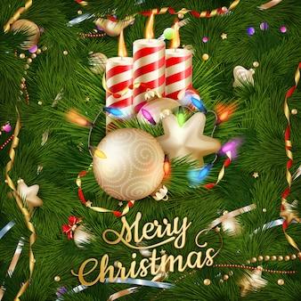 キャンドルと雪の背景のクリスマス飾り。