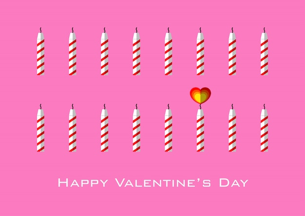Candles with heart shaped flame for valentine's day - pink background