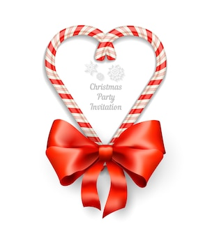 Candy canes in heart shape frame with text for christmas invitation