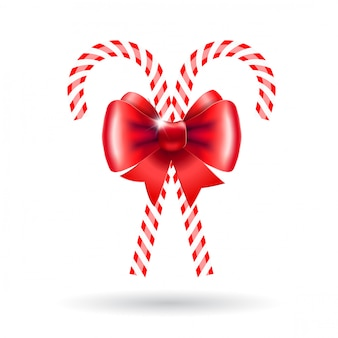Candy canes with red bow.