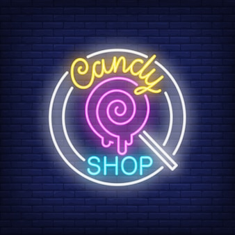 Candy shop neon sign. pin-up lollipop on stick in circle on brick wall.