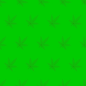 Cannabis leaves pattern on green background