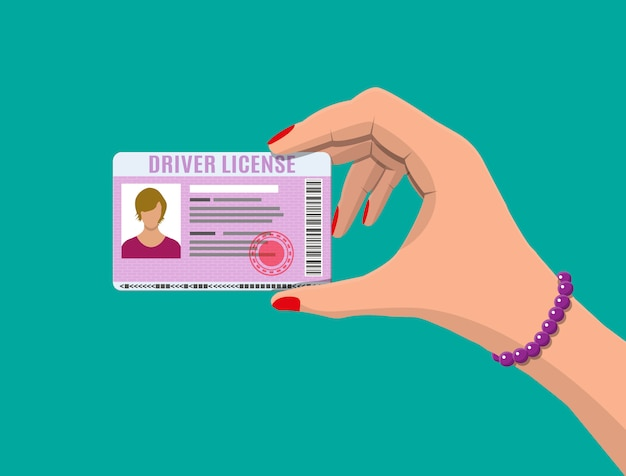車の運転手女性免許証を手に