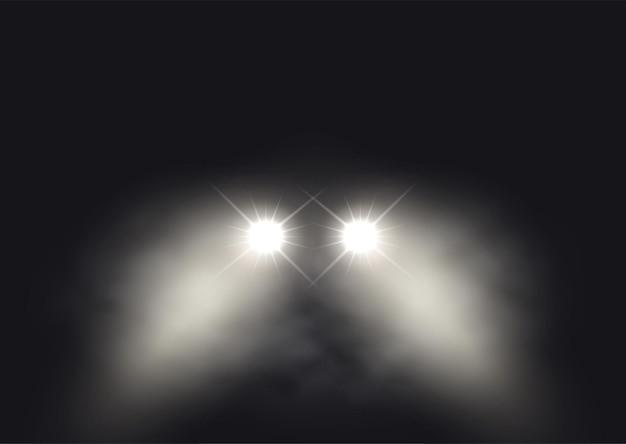 霧の雰囲気のデザインの車のヘッドライト
