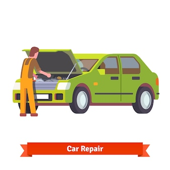 車の修理でエンジンを点検する自動車整備士