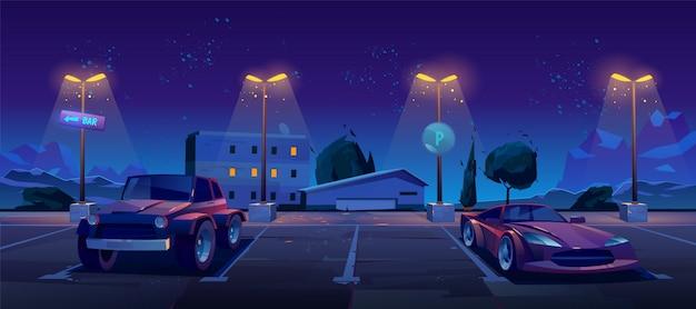 夜の街の通りに駐車場