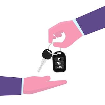 レンタカーまたは販売の概念。車のキーをもう一方の手に与える手。