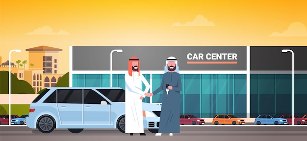 Car showroom background, purchase sale or rental center arab seller man giving keys to owner
