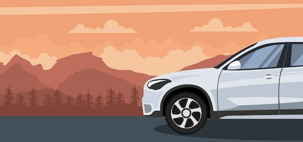 Car on a sunset in the mountains