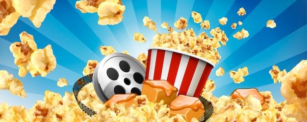 飛ぶトウモロコシとイラストの映画アイテムとキャラメルポップコーンバナー広告