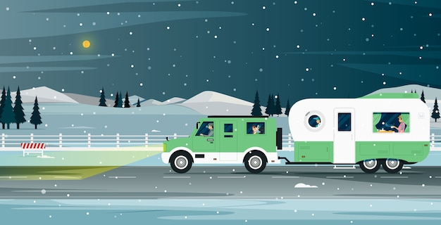 Caravan family travels during the snowy night