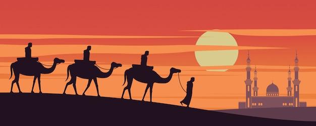 キャラバンイスラム教徒がドバイのモスクにラクダに乗る