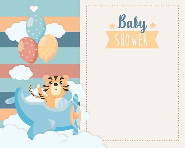 Card of cute tiger in the cradle and clouds