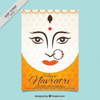 Card of happy navratri with face of the durga goddess