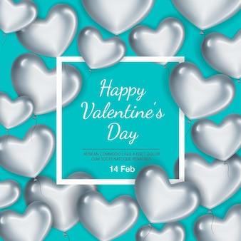 バレンタインデーのフレームとシルバーハートのカード