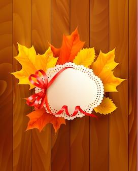 木製の背景に弓と葉のカード。