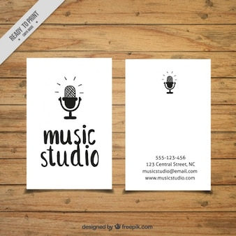 Card with a microphone drawn to a music studio