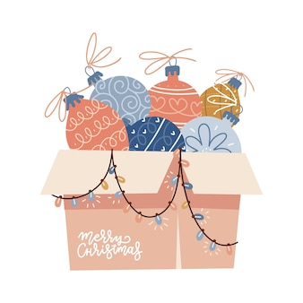 Картонная коробка, переполненная елочными игрушками с безделушками, елочные шары, украшения ...