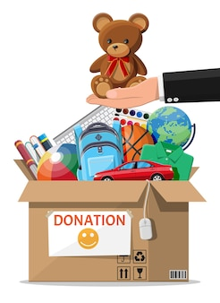 Cardboard donation box full of toys, books, clothes and devices. help for children, support for poor kid. donate container in hand. social care, volunteering, charity concept. flat vector illustration