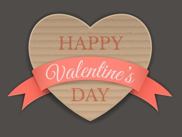 Картонное сердце, обернутое лентой, приветствие дня святого валентина.