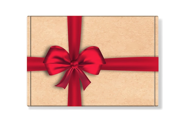 Cardboard package box with big red ribbon bow isolated on white background.