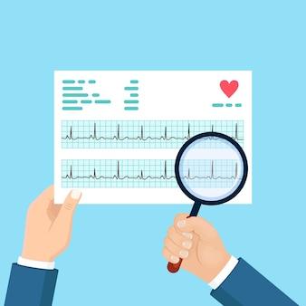 의사 손에 제품 및 돋보기 안경입니다. 심장 박동 리듬 차트