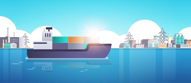 Cargo container ship in sea or ocean over factory buildings industrial zone