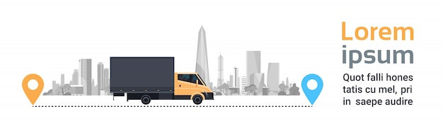 Cargo truck over silhouette city on route. transportation and delivery service concept horizontal banner