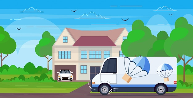 Cargo van truck driving road parcel box with parachute flying down from sky express delivery service concept cottage villa house landscape background  horizontal