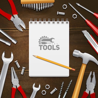 Carpentry construction repair instruments tools with notebook composition on dark wood background
