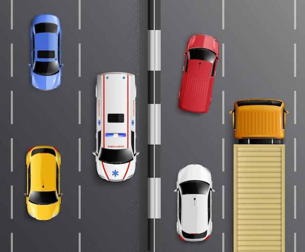 Auto vista dall'alto composizione realistica con barriera di corsie di traffico e auto colorate con ambulanza e illustrazione di camion