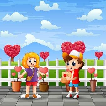 公園の風景の中のカップルの子供たちを漫画