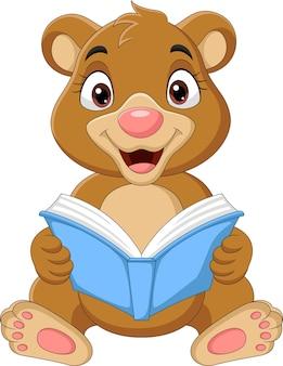 Cartoon baby bear reading a book