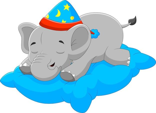 베개에 잠자는 만화 아기 코끼리
