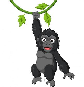 木の枝にぶら下がっている漫画赤ちゃんゴリラ