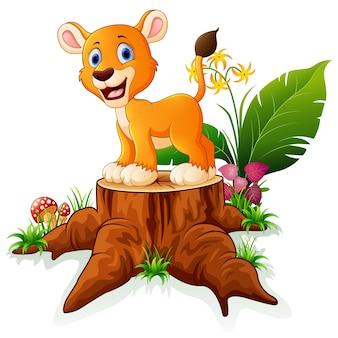 Cartoon baby lion on tree stump
