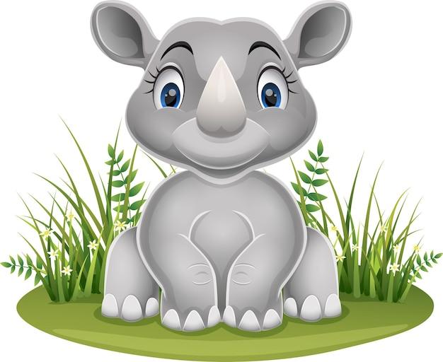 잔디에 앉아 만화 아기 코뿔소