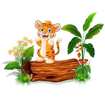 Cartoon baby tiger on tree trunk