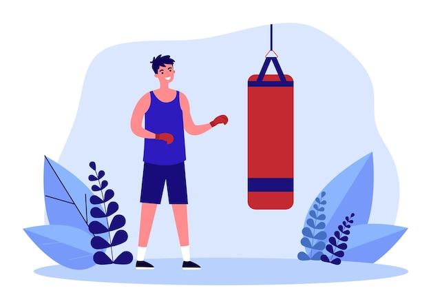 샌드백 앞에 서 있는 만화 권투 선수. 권투 장갑 훈련 평면 벡터 일러스트 레이 션에 남자입니다. 배너, 웹 사이트 디자인 또는 방문 웹 페이지를 위한 스포츠, 피트니스, 건강한 라이프스타일 개념