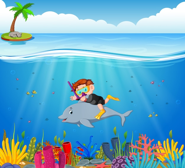 Cartoon boy diving in the sea with dolphin