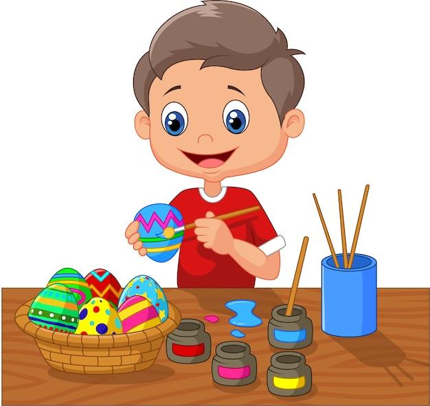 Cartoon boy painting easter egg