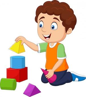 Мультяшный мальчик играет со строительными блоками