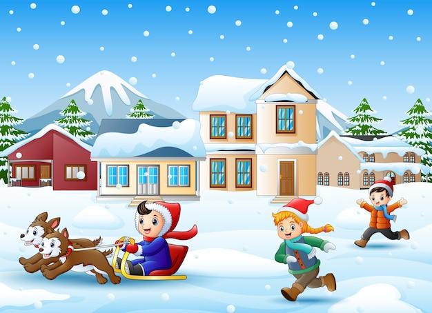 Cartoon boy riding sled on the snowing village