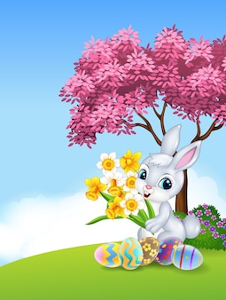 Cartoon bunny holding flower with colourful easter eggs