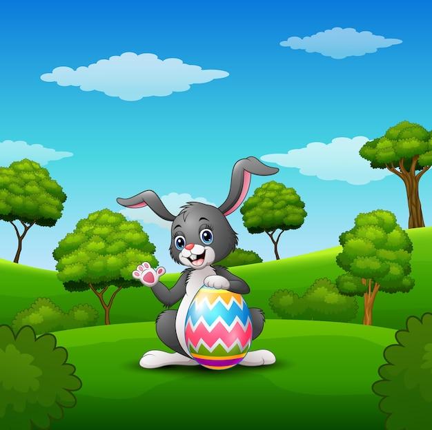 Cartoon bunny waving hand